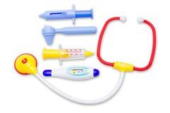 A criança brinca o conjunto de ferramentas do equipamento médico Foto de Stock Royalty Free
