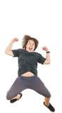 Criança carnudo ou menino que sorriem com expressão e salto da cara Foto de Stock