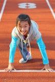 A criança chinesa prepara-se para começar funcionar Imagens de Stock