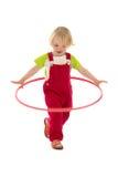 Criança com aro do hula Imagens de Stock Royalty Free