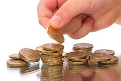 Criança com as moedas de uns 10 rublos Imagem de Stock Royalty Free