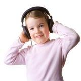 Criança com auriculares Foto de Stock Royalty Free