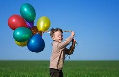 Criança com balões Fotografia de Stock Royalty Free