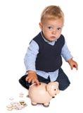 Criança com banco piggy Imagens de Stock