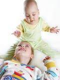 Criança com bebê Fotos de Stock Royalty Free