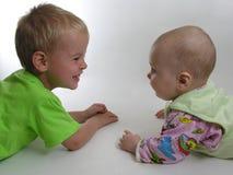 Criança com bebê Fotografia de Stock