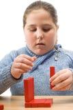 Criança com blocos de apartamentos Fotos de Stock