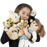 Criança com bonecas Fotos de Stock Royalty Free