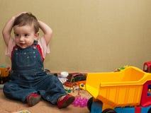 Criança com brinquedos Fotos de Stock