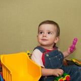 Criança com brinquedos Foto de Stock Royalty Free