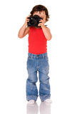 Criança com câmera. imagem de stock