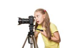 Criança com a câmera, isolada Fotografia de Stock Royalty Free