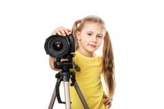 Criança com a câmera, isolada Fotografia de Stock