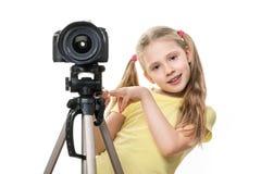Criança com a câmera, isolada Imagens de Stock Royalty Free