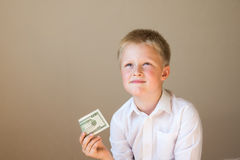 Criança com dinheiro (20 dólares) Fotografia de Stock Royalty Free