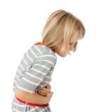 Criança com dor de estômago Fotografia de Stock Royalty Free