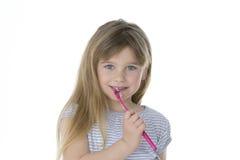 Criança com escova de dentes Fotos de Stock Royalty Free
