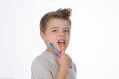 Criança com escova de dentes Foto de Stock Royalty Free