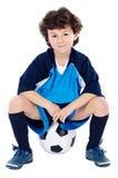 Criança com esfera de futebol Fotos de Stock