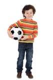 Criança com esfera de futebol Imagens de Stock