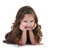 Criança com expressão perniciosa em Backgr branco Fotografia de Stock