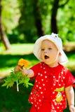 Criança com flor Fotos de Stock Royalty Free