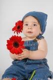 Criança com flores Imagens de Stock Royalty Free