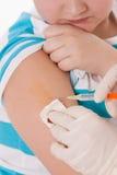 Criança com injeção Imagem de Stock Royalty Free