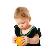 Criança com laranja Fotos de Stock