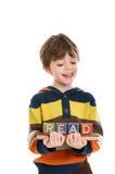 Criança com livro e blocos Fotografia de Stock Royalty Free