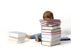 Criança com livros Fotos de Stock