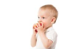 Criança com maçã imagem de stock
