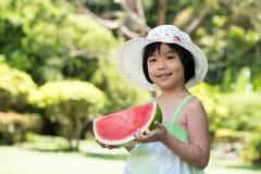 Criança com melancia Imagens de Stock