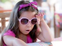 Criança com menu Fotografia de Stock