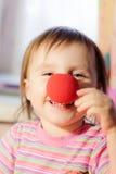 Criança com nariz vermelho Fotografia de Stock