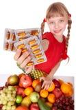 Criança com o comprimido da fruta e da vitamina. Imagem de Stock Royalty Free