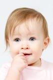Criança com o dedo na boca fotografia de stock