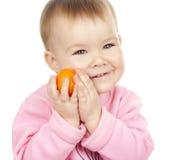 Criança com o mandarino Fotos de Stock