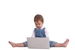A criança com o portátil Fotografia de Stock