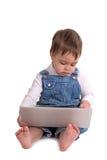 A criança com o portátil Fotos de Stock Royalty Free
