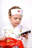 Criança com o telefone que joga um doutor Fotografia de Stock Royalty Free