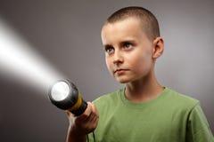 Criança com o tiro do conceito da lanterna elétrica imagem de stock royalty free