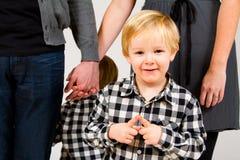 Criança com pais no estúdio Imagem de Stock