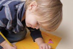 Criança com pastel, artes Fotos de Stock Royalty Free