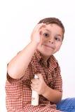 Criança com perfume Fotos de Stock Royalty Free