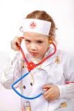 Criança com phonendoscope do brinquedo Fotos de Stock Royalty Free