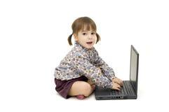 Criança com portátil Fotos de Stock