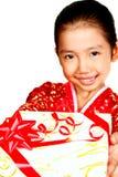 Criança com presente Imagens de Stock Royalty Free