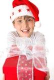 Criança com presente de Natal fotos de stock
