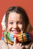 Criança com revestimento e lenço Fotos de Stock Royalty Free